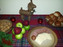 Yule supper of sausage, cheese, bread, apples, walnuts, and hazel nuts (filberts).